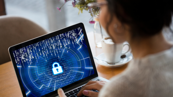 Woman looking at computer - cybersecurity best practices